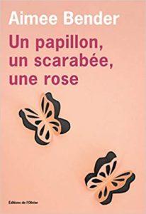 livre un papillon un scarabee une rose